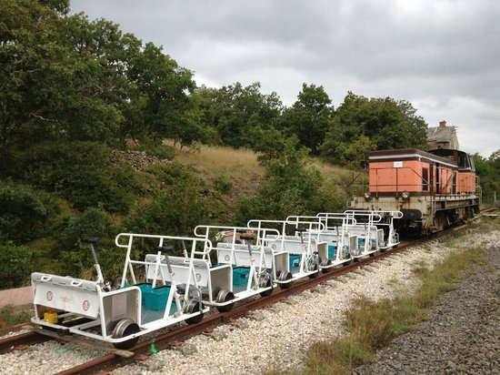 Velorail du Larzac: A row of bikes with one of the locomotives.