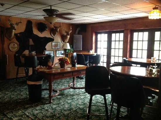 Bavarian Manor Country Inn & Restaurant: This is part of the bar area with seating and access to our side porch with outdoor seating.