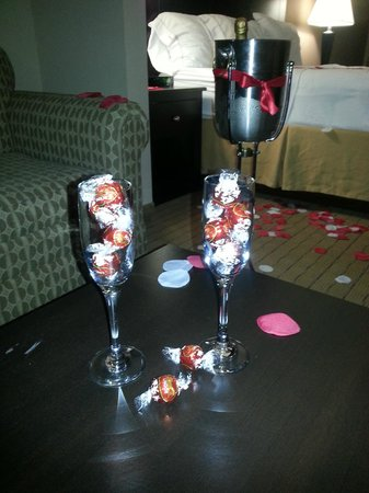 Holiday Inn Express & Suites Fort Myers- The Forum: Champagne bottle chilled w/ 2 glasses & chocolates