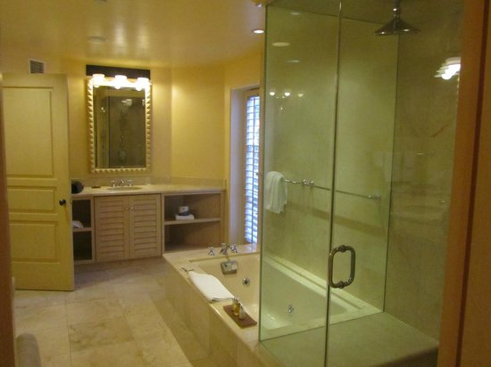 La Valencia Hotel: Bathroom with two vanity areas, a whirlpool tub, and steam shower