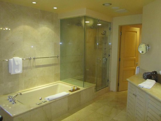 La Valencia Hotel: View of whirlpool tub, steam shower, and entrance to private toilet area.