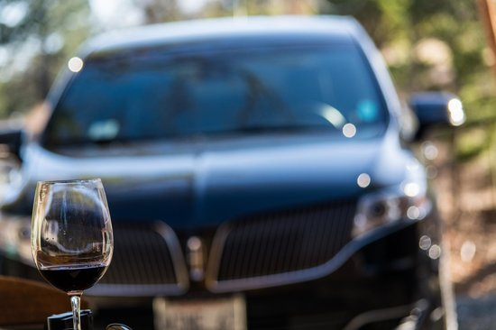 Napa Valley Tours & Transportation: Lincoln MKT behind a glass of Cab