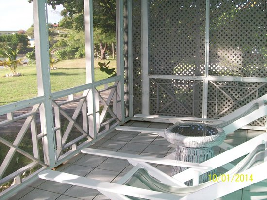 Oualie Beach Resort: porch off front of cottage