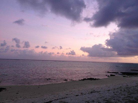 Le Peninsula Bay Beach Resort: coucher de soleil