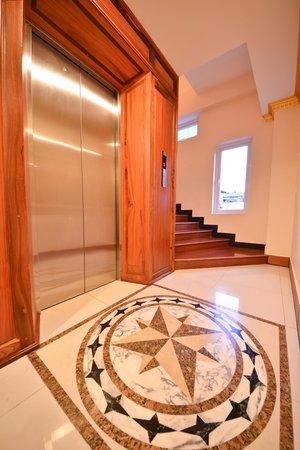 Golden House International: Elevator