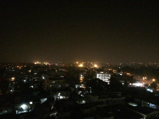 Lemon Tree Premier : Night city view from Roof Top pool.