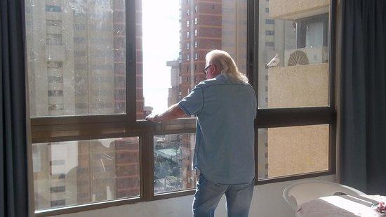 Gemelos XX Apartments: Hubby enjoying sun