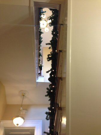 Dupont Mansion B&B : Looking up from first landing, up to third floor (decorated for the holidays)