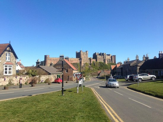 St Aiden Beach : Bamburgh Village from The Grove