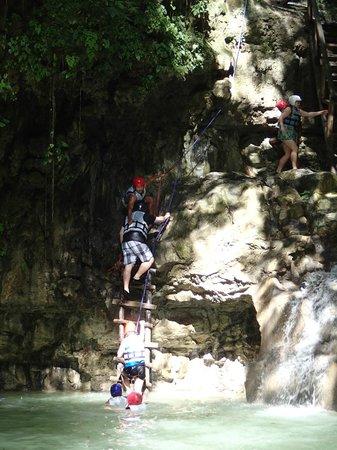 Grand Paradise Playa Dorada: Climbing up the waterfall.
