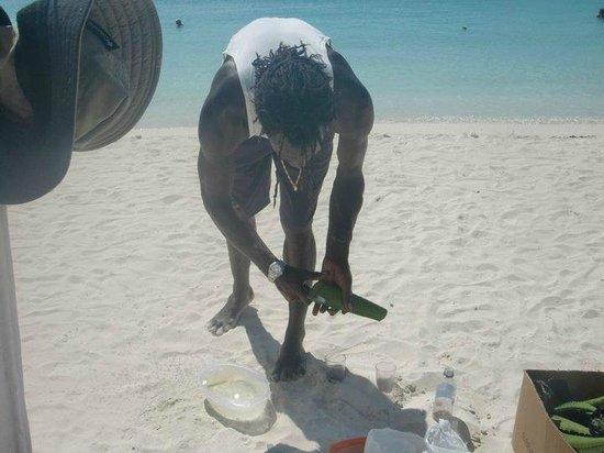 "Sandals Grande Antigua Resort & Spa : kevin, our ""beach doctor""-coco massage and aloe vera relief"