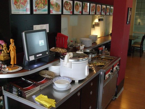 Thai Food Corner: Buffet items and wall menu board