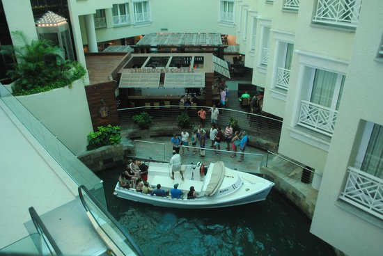 Renaissance Aruba Resort & Casino: Boat pick up in the lobby to the private island.