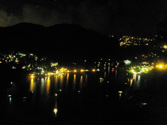 The Inn On The Bay: night view of marigot bay from the deck