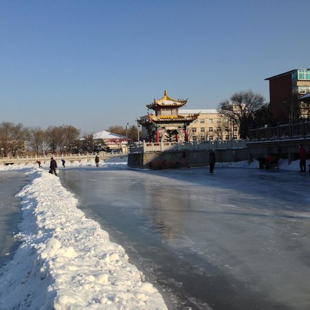 Liaoyang White Tower Park: Speed Skating Oval Beside A Pagoda
