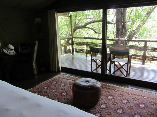 ‪‪Takadu River Camp Lodge‬: Our room with a nice veranda where you could watch animals from‬