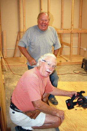 Tubac Center of the Arts: Board President, Mike Jacoby & Volunteer, Pete Benequista building shelving
