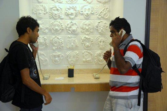 Lemon Tree Hotel, Chandigarh: my 2 friends making phone calls