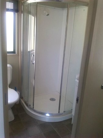 Sandspit Holiday Park : Bathroom - toilet, shower, basin, mirror - has a shower cover which is great at containing steam