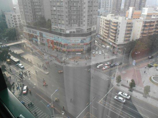 Metropark Hotel Shenzhen: 9th floor room, looking down on the busy street below