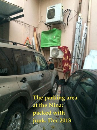 Nina Cafe Suites Hotel : Pricey parking is full of junk