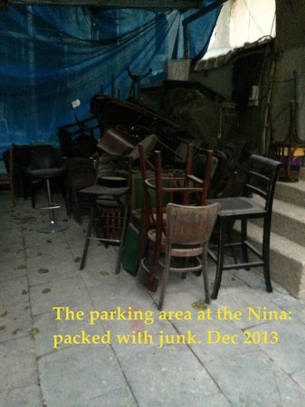 Nina Cafe Suites Hotel: Parking area: filled with so much junk, it was hard to park the car