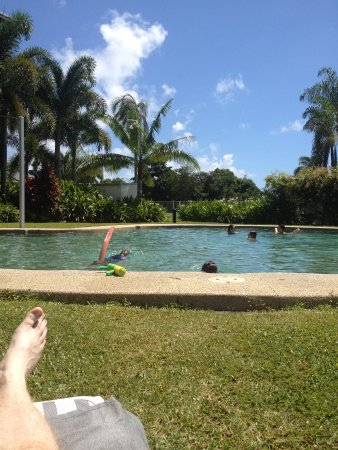 The Sebel Palm Cove Coral Coast: Excuse the white toes. Very pleasant pool side