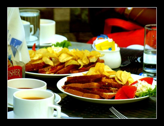 Comfort Inn: Mouthwatering grilled cheese sandwich with ginger tea at 'The gourmet Terrace' restaurant