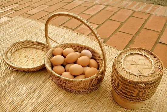 The Belle Rive Boutique Hotel: Some boiled eggs, sticky rice, with mat (prepare for the monks)
