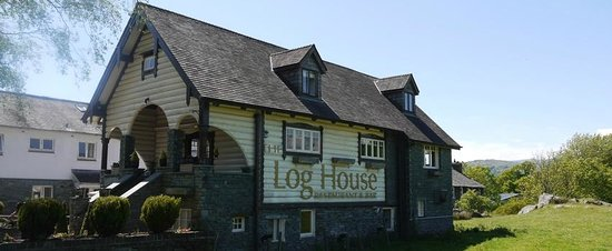 ‪The Log House‬