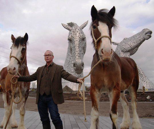 Falkirk, UK: Kelpie artist Andy Scott alongside Kelpie life models, Duke and Baron, the Clydesdale horses.