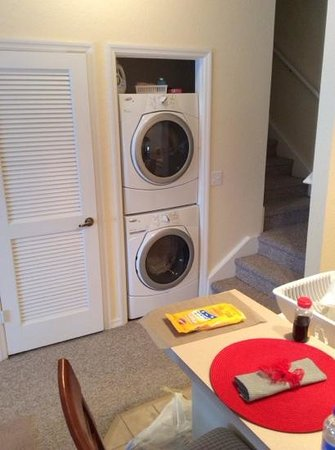 Venetian Bay Resort: a full size washer and dryer right off the kitchen and stairwell leading to two additional rooms