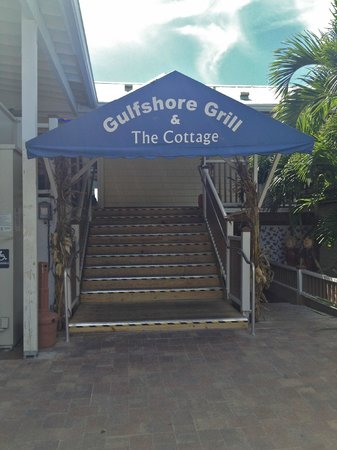 The Cottage Bar and Gulfshore Grill: Look for the signature blue awning to find this hidden gem!