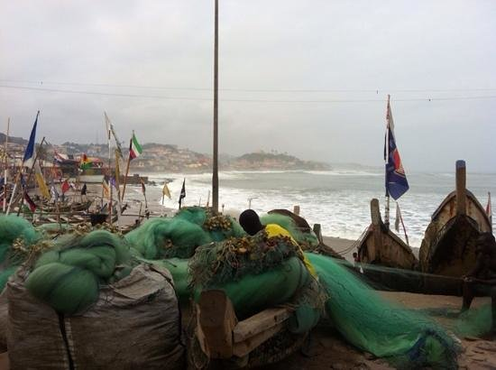 fishermen and their boats outside cape coast castle