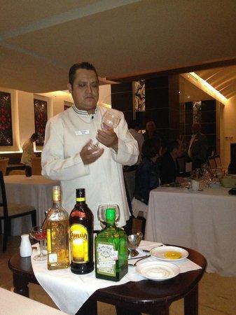Grand Velas Riviera Nayarit: Waiter making specialty drink tableside