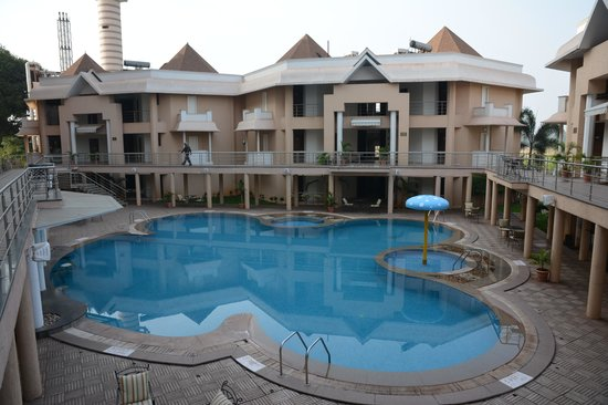 Royal Orchid Central Kireeti : Swimming Pool Between Three Buildings