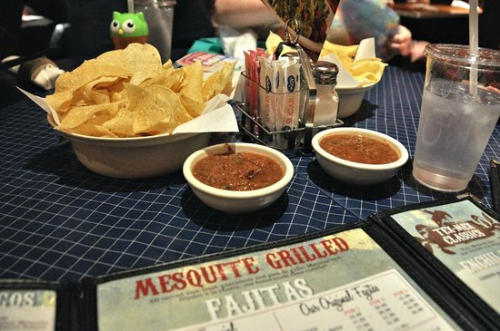 Uncle Julio's: The chips are crispy and not greasy; salsa has a smoky chipotle taste.