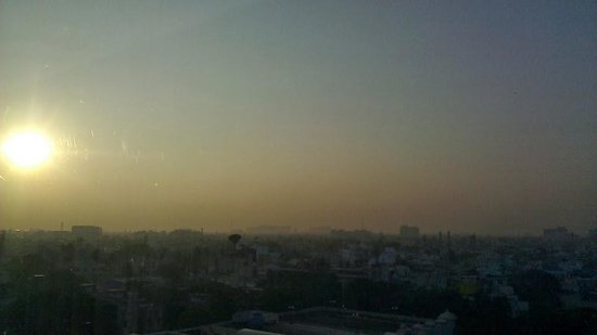 Hyatt Regency Chennai: the setting sun over the city... a view from the room