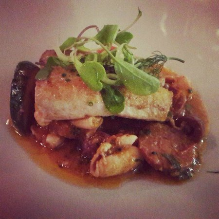 Planet Restaurant: Pan fried angelfish with calamari, choriso, tomato, smoked olives and basil