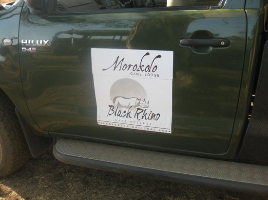 Morokolo Game Lodge : Lodge Label on game drive car