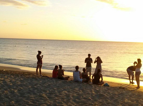 Combate Beach Resort : A group awaiting for the sunset at Combate Beach