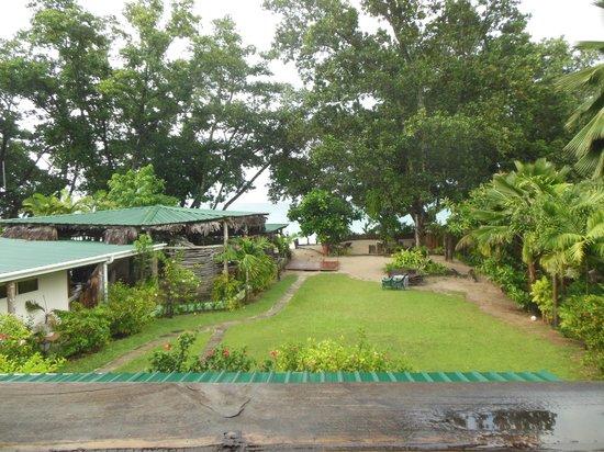 Augerine Guest House: vue sur le jardin, le restaurant, la plage