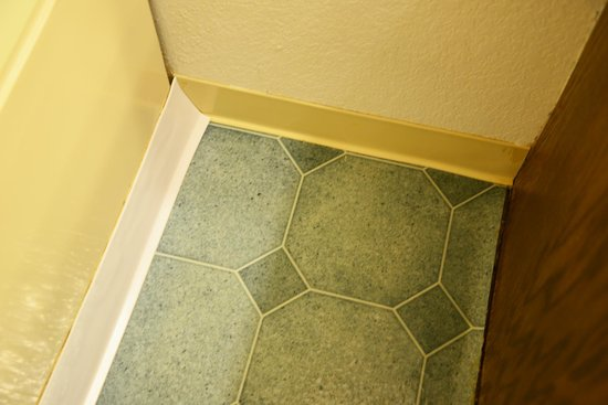 Inn at Silver Creek: Plastic baseboards put up to hide rot from water damage