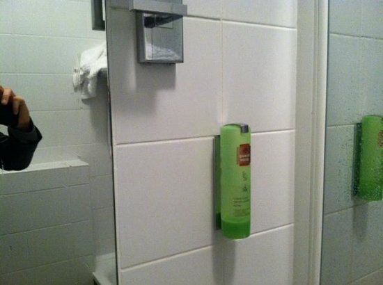 Hotel Carlton's: plastic liquid soap bottle on the wall