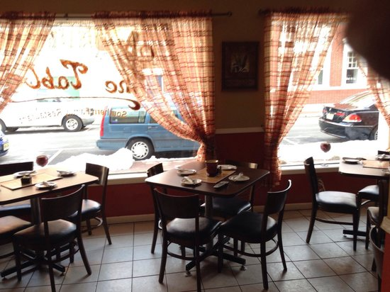 At the Table: Window seating.