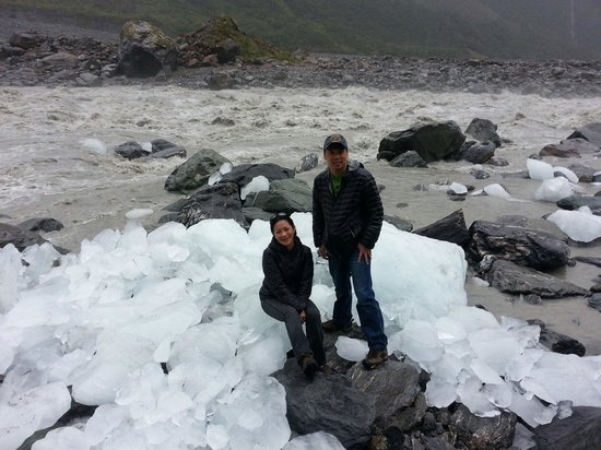 Fox Glacier Hiking Trails: Washout glacier iceberg at the river. Strong current river behind. See what happen to the ice ju
