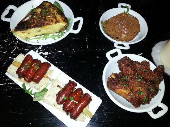 The Port House Pintxo : Txistoras Chargrilled, tortilla Espanola, frango piri piri, battered mushroom & goats cheese