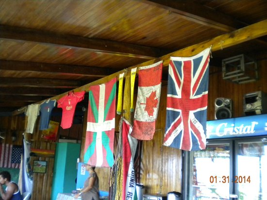 Hostel Vista Serena : Many different flags hang with signatures from past guests.