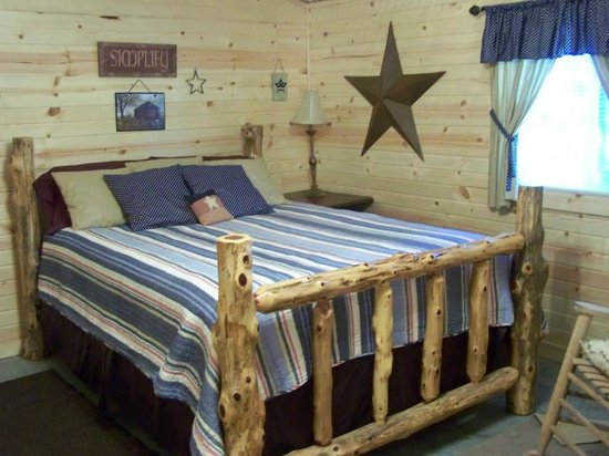 The Gathering Place Retreat Center: The Cabin has a log bed custom made by a local craftsman
