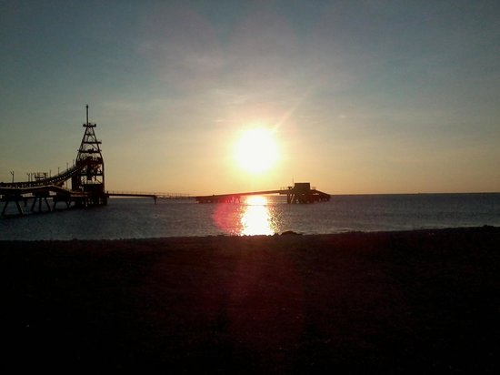Divi Flamingo Beach Resort and Casino: sunset at the salt pier